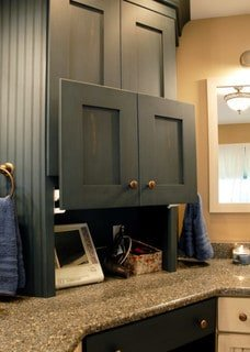 traditional bathroom with lift door storage