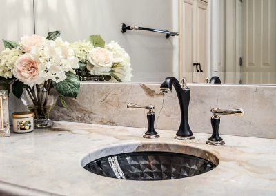 Feminine master bath, black and gold-tipped fixtures